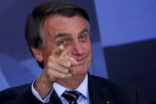 Brazil's President Bolsonaro gestures during a ceremony in Brasilia