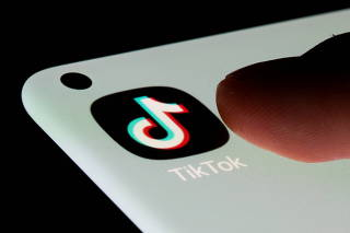 FILE PHOTO: FILE PHOTO: TikTok app is seen on a smartphone in this illustration