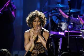 FILE PHOTO: Singer Houston blows kisses at crowd at conclusion of her performance at the 2009 Grammy Salute to Industry Icons event in Beverly Hills