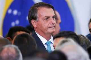 Brazil's President Jair Bolsonaro looks on during a ceremony at the Planalto Palace, in Brasilia