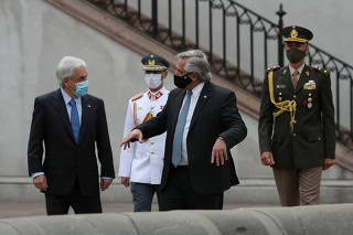 Chile's President Pinera and Argentina's President Fernandez meet at the government house in Santiago