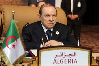 FILE PHOTO: Algerian President Abdelaziz Bouteflika attends the opening session of the first Gas Exporting Countries Forum summit in Doha