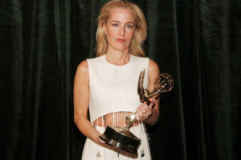 Gillian Anderson poses with her Emmy award for Outstanding Supporting Actress in a Drama Series, backstage at the Netflix UK Primetime Emmy for