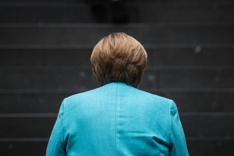 TOPSHOT - German Chancellor Angela Merkel arrives at the house of the Federal Press Conference (Bundespressekonferenz) on July 22, 2021 in Berlin, to address a press conference on national and international topics. (Photo by STEFANIE LOOS / AFP)