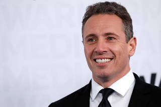 FILE PHOTO: CNN anchor Chris Cuomo poses as he arrives at the WarnerMedia Upfront event in New York