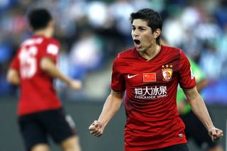 Dario Conca of China's Guangzhou Evergrande celebrates after scoring a goal against Brazil's Atletico Mineiro during their 2013 FIFA Club World Cup third place soccer match in Marrakech stadium