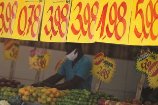 Prices are displayed at a market in Rio de Janeiro