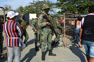 Ecuador seeks to restore order after prison riot kills inmates, in Guayaquil