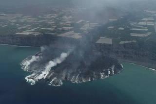 Spain's La Palma coastline expands after lava pours into the ocean