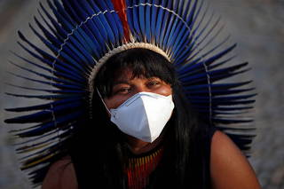 Indigenous Brazilians from different ethnic groups take part in a protest for land demarcation and against President Jair Bolsonaro's government