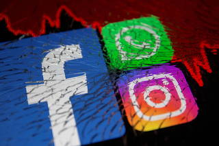 Facebook, Whatsapp and Instagram logos and stock graph are displayed through broken glass in this illustration