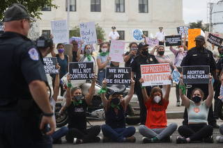 People protest for and against abortion rights outside of the U.S. Supreme Court building in Washington