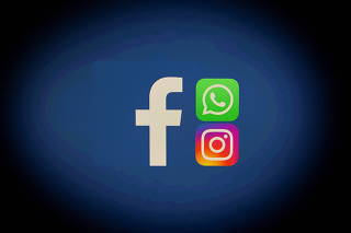 Facebook, Whatsapp and Instagram logos are displayed in this illustration