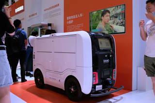 Autonomous delivery vehicle by Damo is displayed at the World Artificial Intelligence Conference in Shanghai