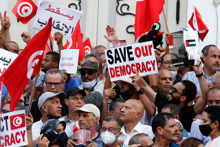 Demonstrators protest against Tunisian President Kais Saied's seizure of governing powers, in Tunis
