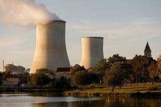 Steam rises from a cooling tower of the Electricite de France (EDF) nuclear power station in Civaux