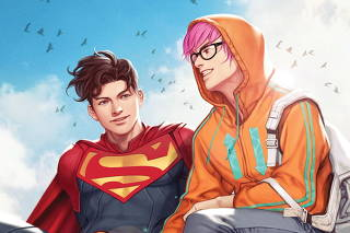 An illustration shows Superman, aka Jon Kent, sitting with reporter Jay Nakamura in the comic book 'Superman: Son of Kal-El'