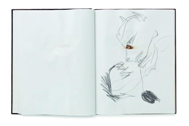 Um caderno com rabiscos de desenho