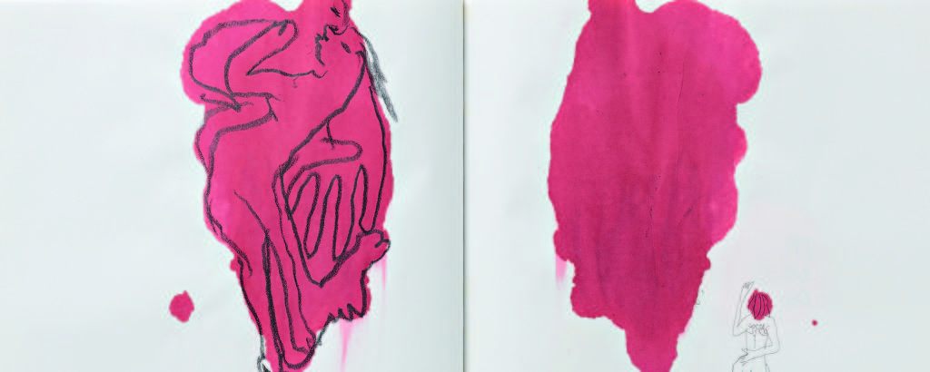 Duas manchas vermelhas em um caderno