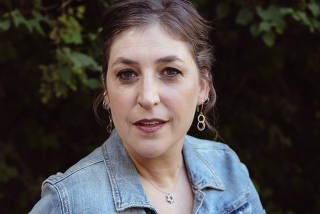 Mayim Bialik sits for a portrait in Los Angeles on Sept. 22, 2021. (Amanda Hakan/The New York Times)