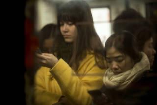 Women in the women-only subway car in Guangzhou, China.
