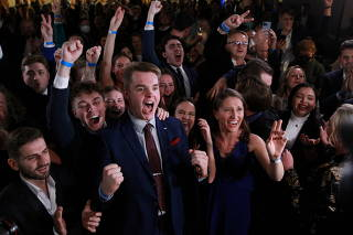 Supporters react to election result at the party's election headquarters, in Prague