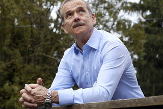 Canadian astronaut Chris Hadfield stands for a portrait at his home in Toronto, Canada on Oct. 5, 2021. (Angela Lewis/The New York Times)