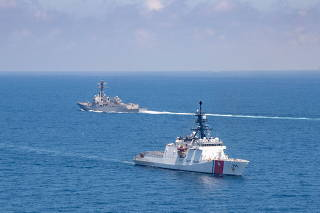 The Arleigh Burke-class guided-missile destroyer USS Kidd and legend-class U.S. Coast Guard National Security Cutter Munro conduct Taiwan Strait transits
