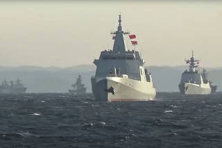 A group of naval vessels from China and Russia sail during joint military drills in the Sea of Japan