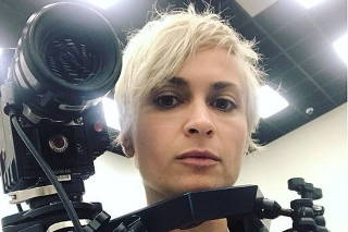 Cinematographer Halyna Hutchins poses for a selfie photo in this picture obtained from social media