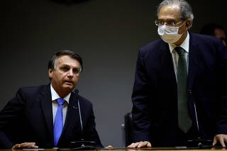 Brazil's President Bolsonaro and Economy Minister Guedes attend a news conference in Brasilia