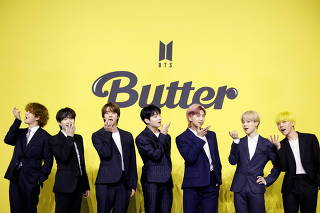FILE PHOTO: Members of K-pop boy band BTS pose for photographs during a photo opportunity promoting their new single 'Butter' in Seoul