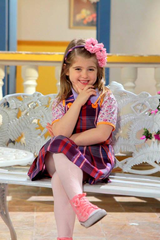 """""""Carinha de Anjo"""" (Netflix) - A novela mostra as aventuras de Dulce Maria (Lorena Queiroz), uma garotinha sapeca que vive momentos mágicos com a família e seus amigos. Foi ao ar originalmente pelo SBT"""