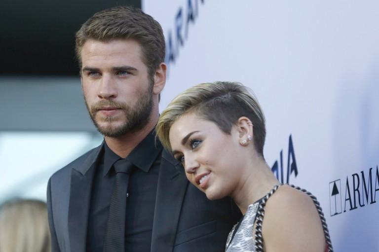 Miley Cyrus com o noivo, o ator Liam Hemsworth